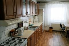 Spoločenská miestnosť s kuchyňou
